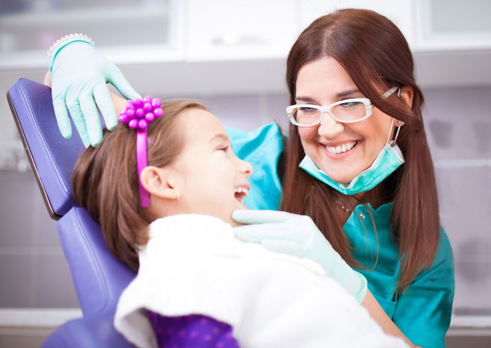 Girl in chair with doctor