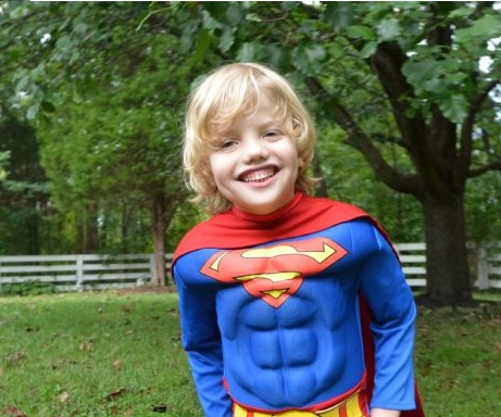 Blond-haired boy with Superman costume