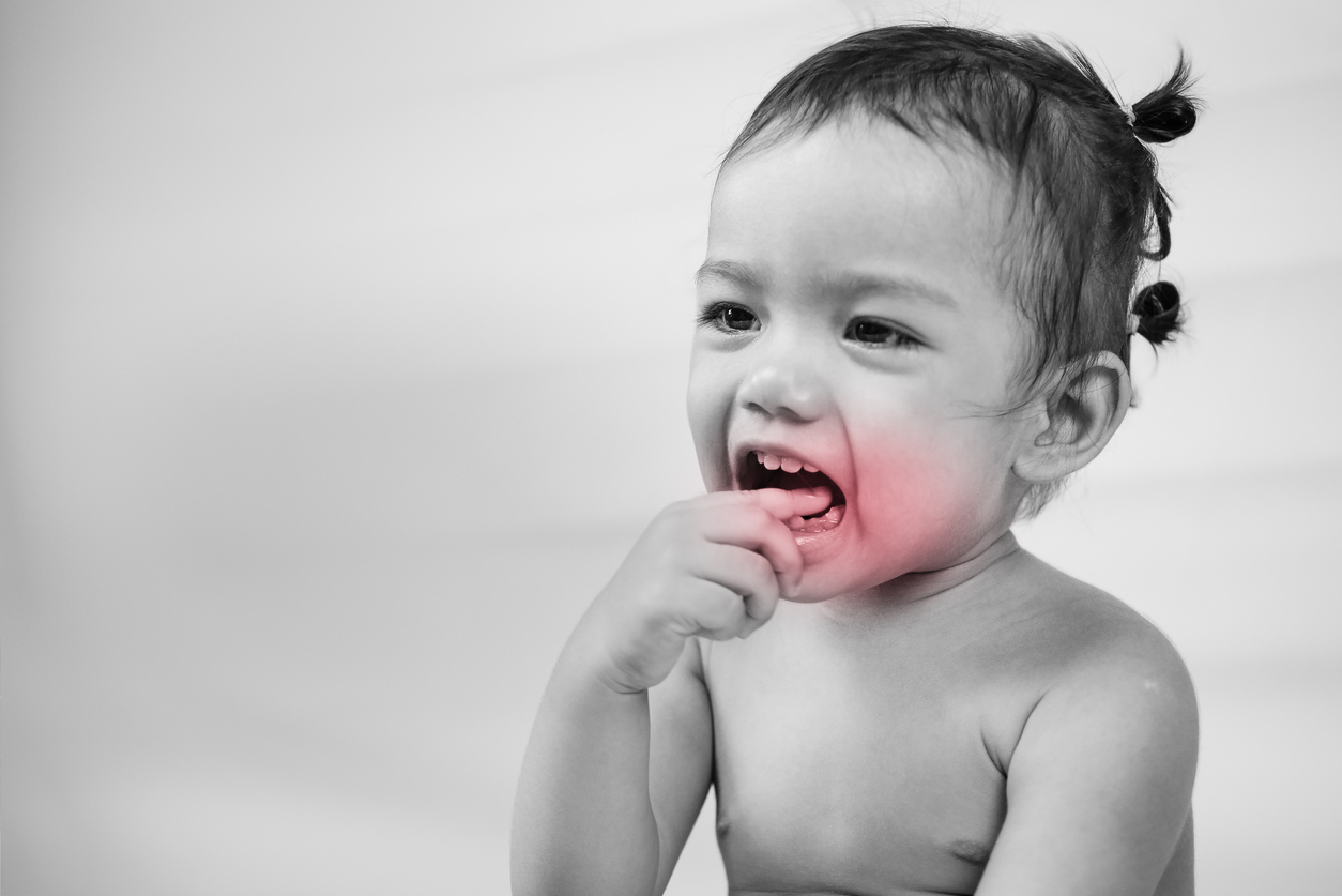 little girl child have toothache with red effect.